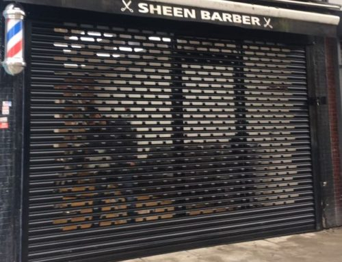 Aluminium Shop Front Secured with Punch Hole Roller Shutter